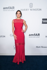 Michelle Rodriguez looked supremely elegant at the amfAR Hong Kong Gala in a red column dress with laser-cut panels.