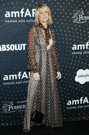Robin Wright went boho in a printed maxi dress by Giambattista Valli at the amfAR Celebrity Poker Tournament.