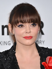 Rose McGowan enhanced her plump pout with light-red lip color.