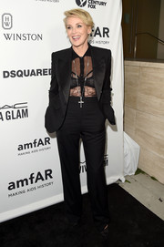 Sharon Stone worked an ambisexual vibe in a black tuxedo teamed with a see-through shirt during the amfAR Inspiration Gala.