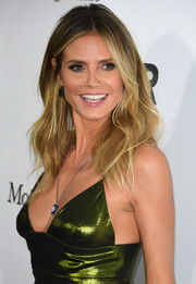 Heidi Klum looked chic with her tousled waves at the amfAR Inspiration Gala Los Angeles.