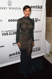 Rocsi Diaz put her enviable curves on display in a figure-hugging lace fishtail gown at the amfAR Inspiration Gala.