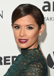 Rocsi Diaz sported a sleek side-parted bun at the amfAR Inspiration Gala.