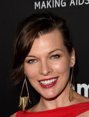 Milla Jovovich swept her hair back into a loose bun for the amfAR Inspiration LA Gala.