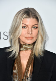 Fergie framed her face with a trendy layered cut for the amfAR Gala in Los Angeles.