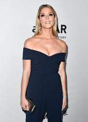 Ashley Greene teamed a silver clutch with a navy off-the-shoulder jumpsuit for the amfAR Gala in Los Angeles.