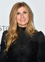 Connie Britton wore her hair in a subtly wavy style with an off-center part when she attended the amfAR Gala in Los Angeles.