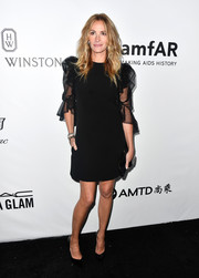 Julia Roberts looked simply lovely in a Givenchy LBD with sheer puff sleeves at the amfAR Gala in Los Angeles.