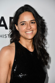 Michelle Rodriguez wore her hair in loose curls at the amfAR Gala in Los Angeles.