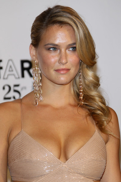 Bar Rafaeli arrived at the amfAR Milano 2011 event radiating glamour. To try her retro style, set dry hair in hot rollers. To relax the curls slightly, brush tresses with a natural bristle brush, then make a deep side part. Smooth the hair on the top of the head and spritz curls with a medium-hold hairspray.