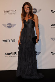 Actress Alessia Piovan showed off her glamorous side while hitting the amfAR Milano red carpet in a strapless gown.