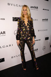 Poppy Delevingne wore an Emilio Pucci beaded suit featuring an embroidered tunic and matching pants to the amFAR Milano 2014 Gala.