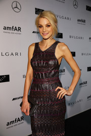 Jessica Stam paired a mirrored gunmetal-gray clutch with a patterned dress for the amfAR Milano event.