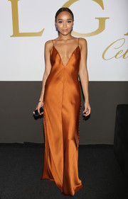 Ashley Madekwe looked simply radiant in a rust-colored silk slip dress by Wes Gordon at the amfAR Milano Gala.
