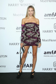 Natasha Poly dazzled at the amfAR Milano 2015 in a purple Roberto Cavalli off-the-shoulder mini dress adorned all over with dangling sequins.