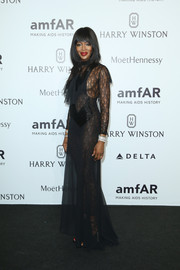 Naomi Campbell sent pulses racing at the amfAR Milano with this Maison Margiela number, in sheer black with a lace catsuit underneath.