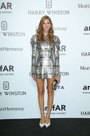 Chiara Ferragni complemented her frock with a pair of studded white pumps.