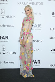 Pixie Lott was sweet and sultry at the same time in a see-through flower-embroidered gown by Blumarine at the amfAR Milano 2015.