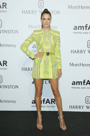 Alessandra Ambrosio gave us an eyeful of leg in an intricately embroidered yellow mini dress by Dsquared2 during the amfAR Milano 2015.