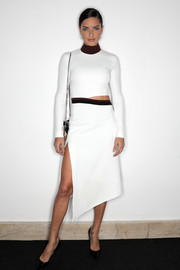 Adriana Lima looked foxy in a high-slit white cutout dress by Mugler at the amfAR Milano 2016.