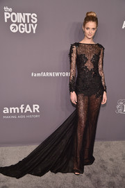 Kate Bock looked alluring in a sheer black lace gown by Berta at the 2019 amfAR New York Gala.