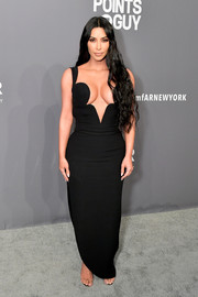 Kim Kardashian made eyes pop with her cleavage-baring, curve-hugging black Versace dress at the 2019 amfAR New York Gala.
