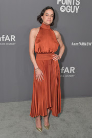 Michelle Rodriguez went for easy sophistication in a pleated rust halter dress by A.L.C. at the 2019 amfAR New York Gala.