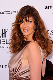 Carol Alt added some volume to her look with long curls. and wispy bangs.