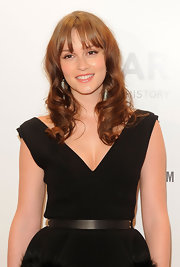 Leighton Meester wore her long curly tresses with wispy bangs at the amfAR Gala in NYC.