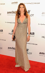 Cindy Crawford donned an intricate geometric beaded gown to the the amfAR New York Gala to kick off Fashion Week.