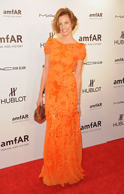 Natalia Andrade wore an orange sequined gown to the amfAR Fashion Week gala.