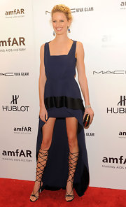 Karolina opted for daring kicks at the amfAR gala in NYC. She donned black strappy sandals complete wit intricate knee-high ties.