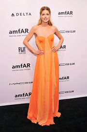 Doutzen was dripping on marigold chiffon at the New York amfAR Gala. We loved the mixture of these sunny hues.
