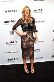 Mary Alice looked high fashion and lovely in this leather-clad gown with delicate lace detailing.