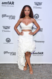 Serayah completed her look with a pair of gold ankle-strap heels.