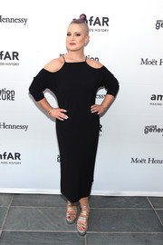 Kelly Osbourne styled her dress with strappy silver platform sandals.
