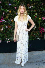 Whitney Port looked appropriately summery in a floral wrap top while attending the Ban.do poolside party.