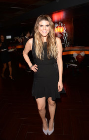 Molly Tarlov was classic and feminine in a sleeveless LBD with a ruffle hem during the boohoo.com event.