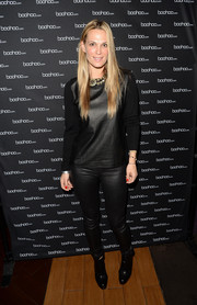 Molly Sims donned a black leather-panel sweater for a rocker-chic vibe at the boohoo.com event.