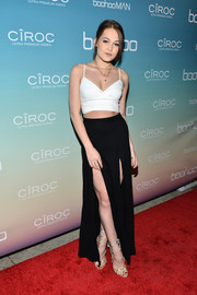 Kelli Berglund kept the sexiness going with a black double-slit maxi skirt.