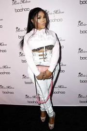 Lil Kim flashed her beaded bra under a cropped pink hoodie at the boohoo.com x Paris Hilton collection launch.