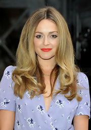 Fearne Cotton showed off her center part curls while at a photo call in London.