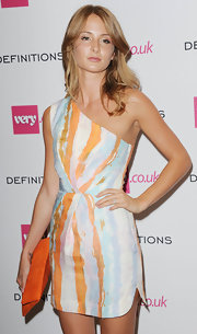 Millie Mackintosh looked chic and vibrant in a printed one-shoulder dress at the Very.co.uk launch party.