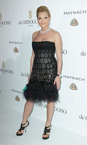 Simona Ventura went for an ultra-glam look with a heavily beaded feather-embellished strapless LBD.