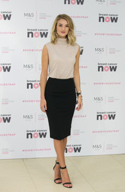 Rosie Huntington-Whiteley teamed her top with a black pencil skirt by Marks & Spencer M&S Collection.