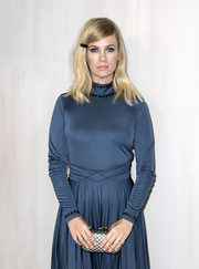 January Jones arrived for the Hammer Museum Gala carrying a grid-patterned satin clutch by Bottega Veneta.