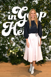 Gwyneth Paltrow styled her outfit with a pair of printed ankle boots by Christian Louboutin.
