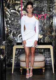 Jaimie Alexander went for a sexy retro look in a white cutout mini dress by Mugler during the harper by Harper's Bazaar event.