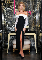 Rosie Huntington-Whiteley attended the harper by Harper's Bazaar event oozing flirty femininity in a black-and-white Alessandra Rich off-the-shoulder dress, which boasted a thigh-high slit, a huge bow and long sleeves, and the brand's signature streamlined silhouette.