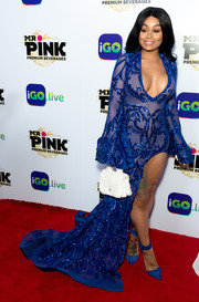 Blac Chyna punctuated her blue look with a white fur purse by Chanel.